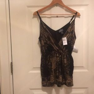 A gold and black romper!